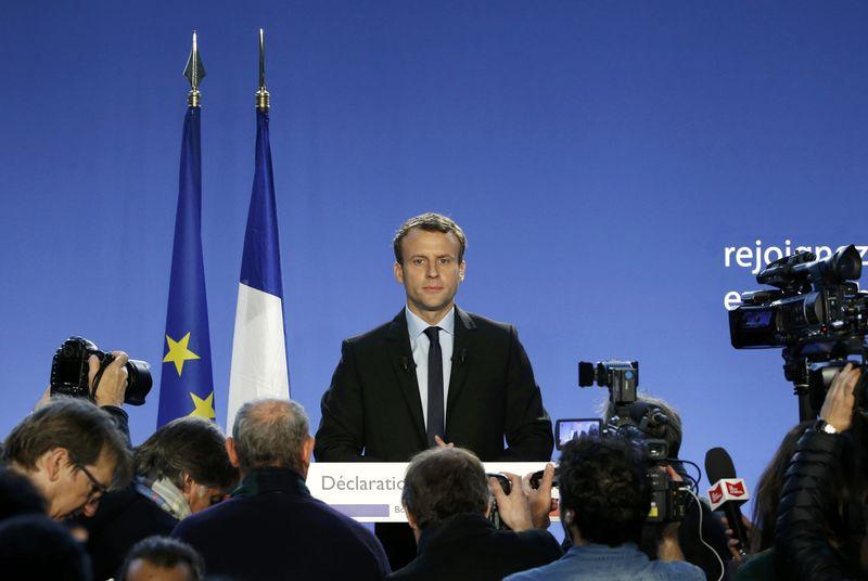 © Reuters. Макрон отклонил требование Британии пересмотреть условия выхода страны из ЕС