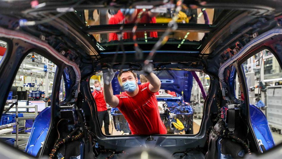 Производство Porsche: Китай вернулся на докризисный уровень Фото: Ян Войтас / DPA